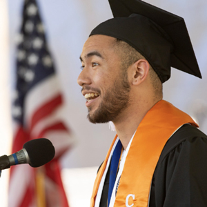 Erick Auginaldo speaking at commencement.