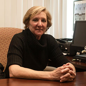 Professor Karen Linkletter sitting in her office.